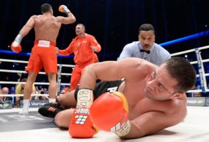 Challenger Bulgarian heavyweight boxer Pulev lies in the ring after being knocked down by Ukrainian WBA, WBO, IBO and IBF heavyweight boxing world champion Klitschko after their title fight in Hamburg